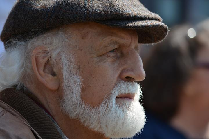 Normal selective focus photography of man in flat cap during 162547