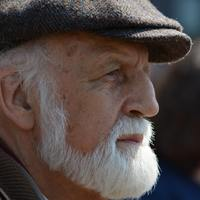 Thumbnail selective focus photography of man in flat cap during 162547