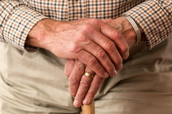 Normal hands walking stick elderly old person