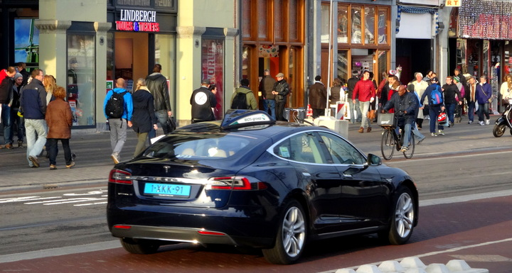 Normal taxi cab blue tesla model s amsterdam