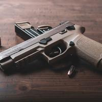 Thumbnail black and silver semi automatic pistol on brown wooden table 3602944