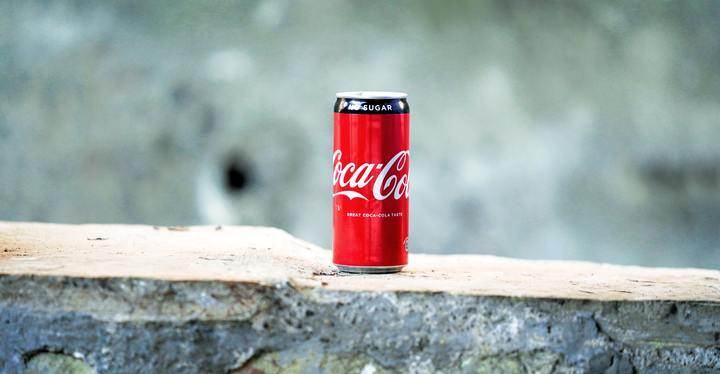 Normal coca cola can on brown concrete surface 877308