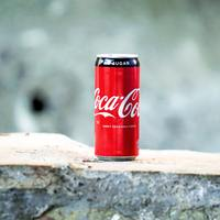 Thumbnail coca cola can on brown concrete surface 877308