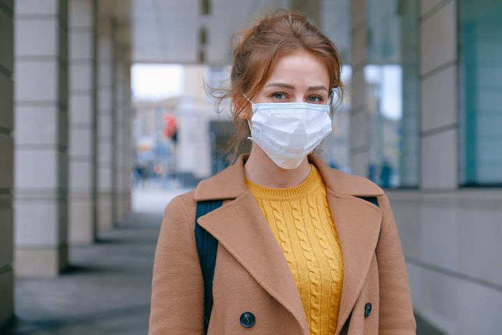 Normal woman wearing face mask 3902881